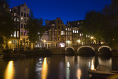 Amsterdam at night 2. Amsterdam at night. A bridge over the Singel canal at night in Amsterdam, the Netherlands Royalty Free Stock Photos