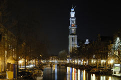Amsterdam by night. Prinsengracht canal and the tower with colorful reflections Stock Image