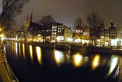 Amsterdam by night. Stunning reflections in Amsterdam canal at night Royalty Free Stock Photo