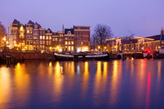 Amsterdam by night at the Amstel in Netherlands Stock Image