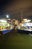 Amsterdam by night - boats near Damrac street Royalty Free Stock Photo