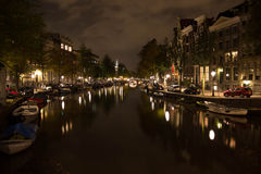 Amsterdam by night, canalstreets Stock Images