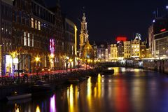 Amsterdam by night in the Netherlands. Amsterdam by night with the Munttower in the Netherlands Royalty Free Stock Photography