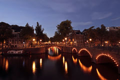 Amsterdam by night in Netherlands Stock Photo