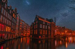 Amsterdam at night in the Netherlands. City scenic in Amsterdam the Netherlands at night Royalty Free Stock Photography