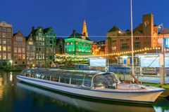 Amsterdam. Night view of the houses along the canal. Royalty Free Stock Images