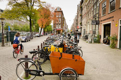 Amsterdam. OCTOBER 20, 2013: Bicycles in  on October 20, 2013.  is worlds most bicycle friendly cities, 57% of traffic covered by bicycles and 760,000 Stock Photos