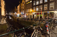 Amsterdam. OCTOBER 22, 2013: Red-light district in  on October 22, 2013 in , Netherlands. There are about three hundred cabins rented by prostitutes in the Stock Photo