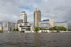 Amsterdam office buildings along river Amstel Royalty Free Stock Photos