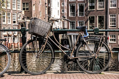 Amsterdam with old bikes on the bridge in Holland Royalty Free Stock Image