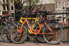 Amsterdam with old bikes on the bridge in Holland Royalty Free Stock Images