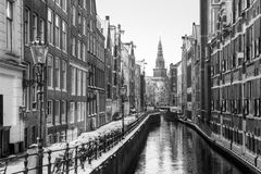 Amsterdam Oudezijds Kolk BW. Beautiful view of the famous Oudezijds Kolk in Amsterdam, the Netherlands, in black and white. In the background is the Oude Kerk Stock Image