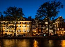 Amsterdam på natten Fotografering för Bildbyråer