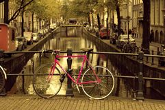 Amsterdam pink bicycle canal stock photo