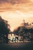 Amsterdam. Quiet Amsterdam canal bridge with bikes Stock Image