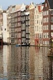 Amsterdam Reflections. Reflections of Amsterdam canal houses royalty free stock image
