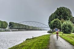 Amsterdam-Rhine canal and new bicycle bridge stock image