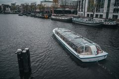 Amsterdam river tram with tourist sightseeing royalty free stock photo