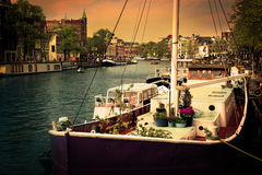 Amsterdam. Romantic canal, boats. Royalty Free Stock Image