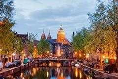Amsterdam rött ljusområde i aftonen Arkivbild