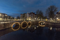 Amsterdam's canal at night Stock Photography