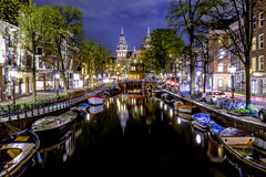Amsterdam's canal at night stock image