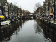 An Amsterdam`s Channel. A nice street in Amsterdam, in the city center. It`s a tourist spot, with some coffees, and remembers shops Stock Image