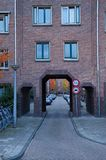 Amsterdam School alley. Amsterdam, Netherlands - 25 October, 2015: a red brick framed alley on the Jozef Israelskade Stock Photo