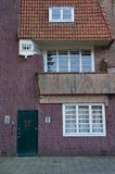 Amsterdam School detail. Amsterdam, Netherlands - 25 October, 2015: Residential building facade in the Nieuwe Pijp Royalty Free Stock Image
