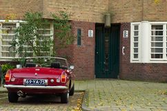 Amsterdam School entrance with vintage MG car. Amsterdam, Netherlands - 25 October, 2015: A classic entrance with a vintage MG car on the Willem Passtoorsstraat Stock Images