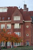 Amsterdam School facade. Amsterdam, Netherlands - 25 October, 2015: Residential building face on the Henrick de Keijserplein Stock Photos