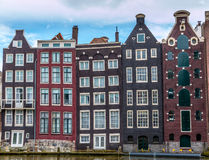 Amsterdam sky line. 16th century homes along an Amsterdam canal Stock Photos