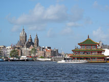 Amsterdam skyline. With floating Chinese restaurant. Urban landscape in Netherlands Royalty Free Stock Image