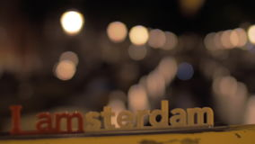 Amsterdam slogan and night cityscape stock footage