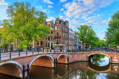 Amsterdam spring canals. Beautiful view of the iconic UNESCO world heritage Prinsengracht and Reguliersgracht canals in Amsterdam, the Netherlands, on a sunny royalty free stock photography