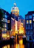 Amsterdam, St. Niklaaskerk by night 2. The famous church  Niklaaskerk in Amsterdam in the evening with Town-Chanel, seen by many tourist visiting Amsterdam Royalty Free Stock Photos