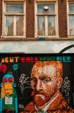 Amsterdam-Straßenkunst - Ikonen auf Wand lizenzfreie stockfotografie