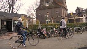 Amsterdam street bike riding stock footage