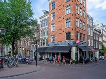 Amsterdam street life during the day royalty free stock photography