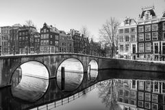 Amsterdam sunrise reflections BW. Beautiful sunrise view of the famous UNESCO world heritage canals of Amsterdam, the Netherlands, in black and white Royalty Free Stock Photography