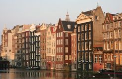 Amsterdam at sunset. Beautiful buildings in Amsterdam at sunset Stock Images