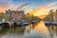 Amsterdam Sunset. City skyline at canal waterfront, Amsterdam, Netherlands stock photo