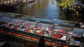 Amsterdam tour boat on Herengracht Canal stock video