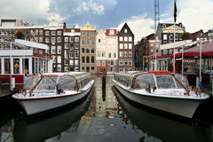Amsterdam Tour Boats. Tour boats and ticket office in Amsterdam canal royalty free stock photos