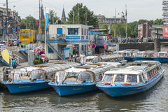 Amsterdam Tourist boats, Netherlands Stock Photo