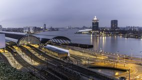 Amsterdam train station cityscape sunset royalty free stock images