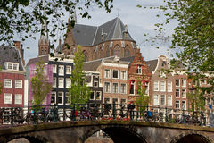 Amsterdam view with bridge and typical dutch houses Royalty Free Stock Photos