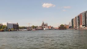 Amsterdam view from the water. Amsterdam waterfron view from a moving boat on a canal tour stock footage