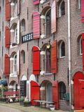 Amsterdam warehouse vrede. Amsterdam old ware house where now living people Stock Photos