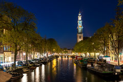 Amsterdam Westerkerk church tower at canal in the city of Amster royalty free stock photography